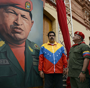 (L to R) Venezuelan Vice President Nicolas Maduro, the president of the National Assembly, Diosdado Cabello and Venezuelan Minister of Defense Diego Molero Bellavia, stand next to a huge portrait of Venezuelan President Hugo Chavez during the conmemoration of the 1992 failed coup led by Chavez, who was an army lieutenant colonel, against then president Carlos Andres Perez, in Caracas, on February 4, 2013