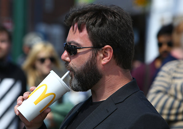 UK Independence Party (UKIP) European Election candidate Carl Benjamin, known by the online pseudonym Sargon of Akkad, drinks a McDonald's drink at a campaigning event in Exeter, southwest England, on May 13, 2019