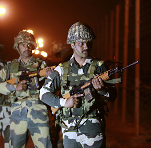 Indian Border Security Force (BSF) soldiers stand guard during a night patrol near the India Pakistan border fencing at Suchet Garh in Ranbir Singh Pura, about 27 kilometers (17 miles) south of Jammu, India, Wednesday, Jan. 17, 2018