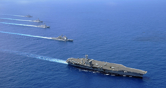 U.S. warships provocatively challenge China's claims in South China Sea