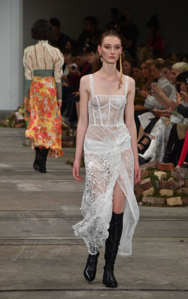 Model Presents Creations by Australian Designers Leo & Lin