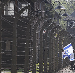 Participants in the Jewish event of Holocaust remembrance walk in the former Nazi German World War II death camp of Auschwitz shortly before the start of the annual March of the Living in which young Jews from around the world walk from Auschwitz to Birkenau in memory of the 6 million Holocaust victims, in Oswiecim, Poland, Thursday, May 2, 2019