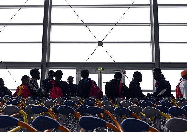 Asylum seekers who have been rescued by the Aquarius rescue ship and another ship in the Mediterranean sea, wait upon their arrival at Roissy-Charles de Gaulle airport, in Roissy-en-France, north of Paris, on August 30, 2018