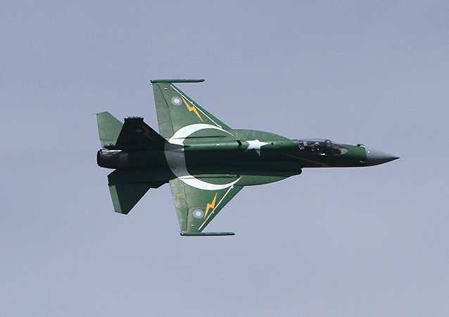A Pakistani JF-17 fighter aircraft flies in a formation during a ceremony to mark Pakistani Defense Day, in Islamabad, Sunday, Sept. 6, 2015