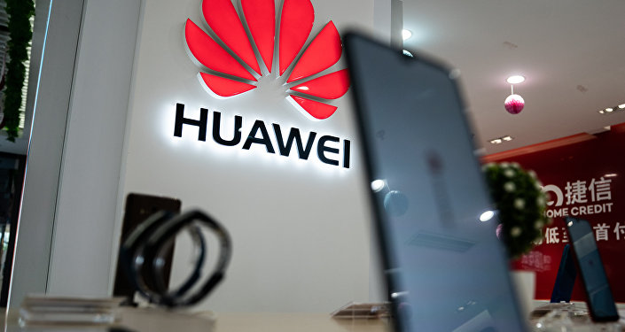 A Huawei logo is displayed at a retail store in Beijing on May 20, 2019