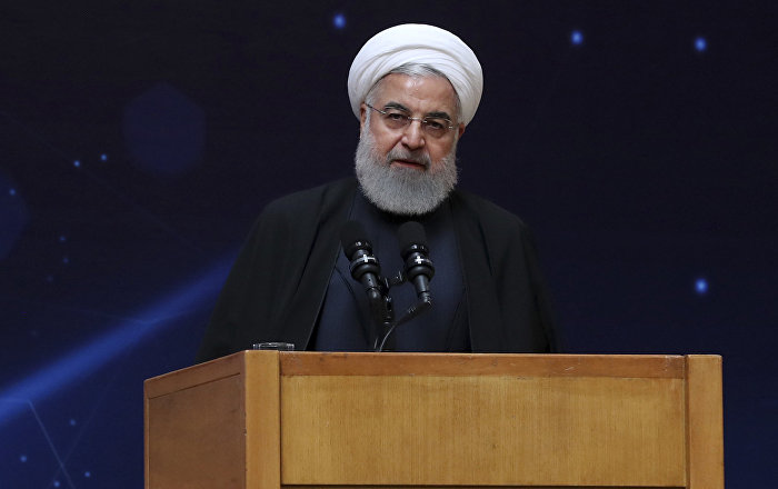 In this photo released by the official website of the office of the Iranian Presidency, President Hassan Rouhani speaks during a ceremony commemorating National Day of Nuclear Technology in Tehran, Iran, Tuesday, April 9, 2019