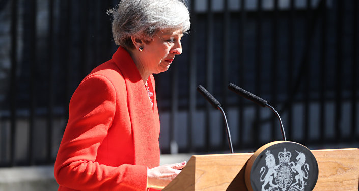 Britain's Prime Minister Theresa May reacts as she announces her resignation outside 10 Downing street in central London on May 24, 2019.