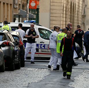 Police officers, fire fighters and medics are seen near the site of a suspected bomb attack in central Lyon, France May 24, 2019. REUTERS/Emmanuel Foudrot