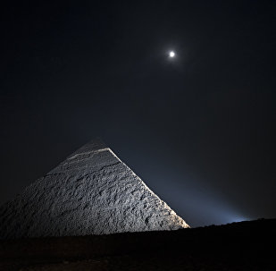 A picture taken on November 16, 2013, shows the moon above a pyramid in Giza, on the outskirts of Cairo