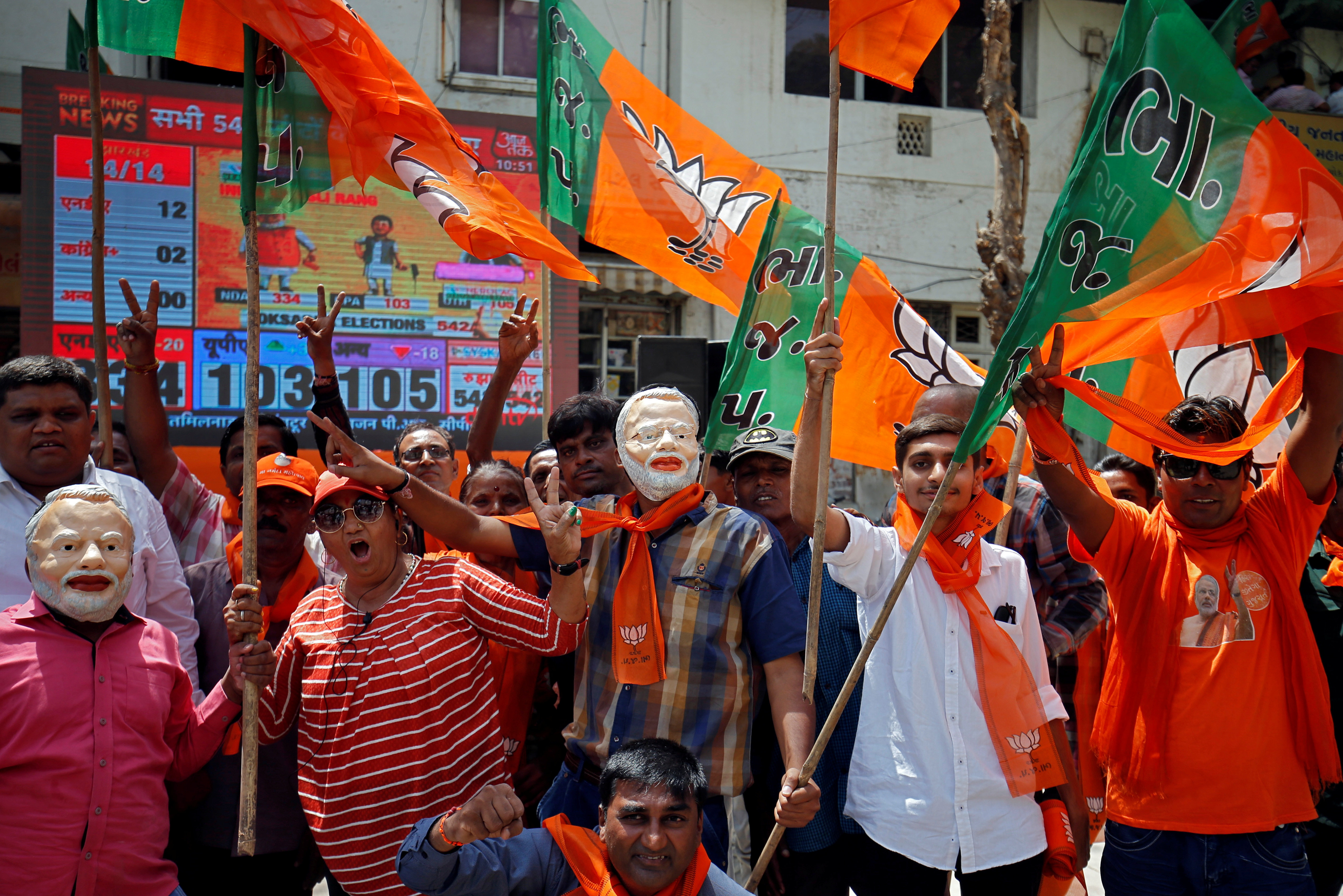 Supporters of Bharatiya Janata Party (BJP) celebrate after learning of initial poll results in Ahmedabad, India, May 23, 2019