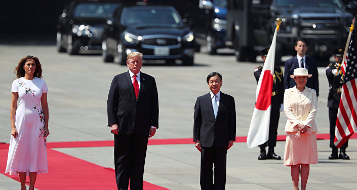 U.S. President Donald Trump and first lady Melania Trump stand next to Japan's Emperor Naruhito and Empress Masako at the Imperial Palace in Tokyo, Japan May 27, 2019. REUTERS/Jonathan Ernst