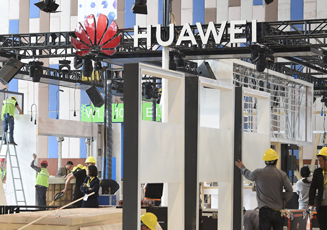 Workers are seen near the booth of Huawei Technologies Co under construction at the venue of China International Big Data Industry Expo in Guiyang, Guizhou province, China May 22, 2019