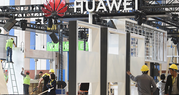 Workers are seen near the booth of Huawei Technologies under construction at the venue of China International Big Data Industry Expo in Guiyang, Guizhou province, China 22 May 2019