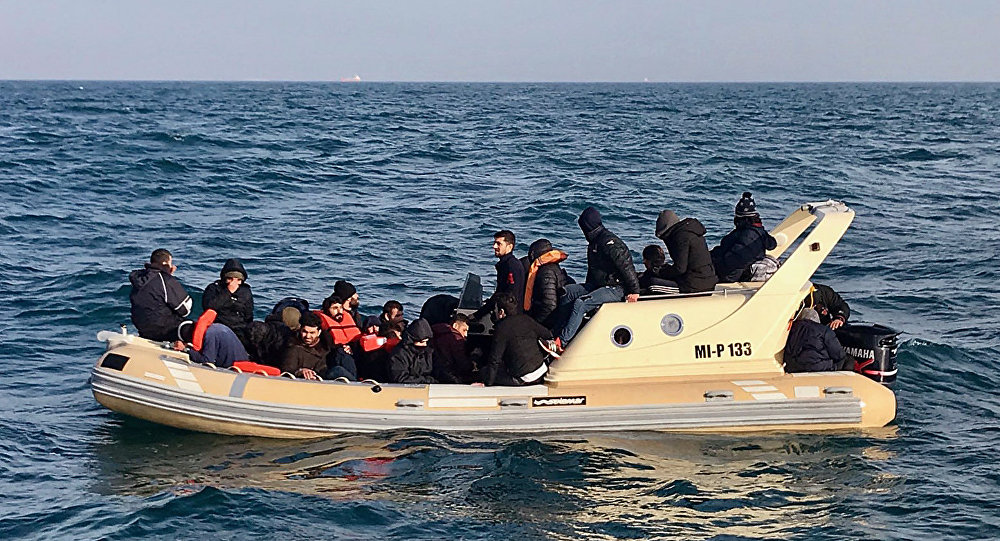 British Rescuers Help Migrants on Boat