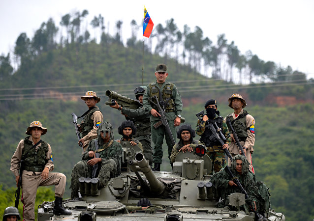 Venezuelan troops in different fatigues and carrying various weapons stand on a Russian-made BMP-3M IFV during the press conference given by Defence Minister general Vladimir Padrino Lopez at Fort Tiuna in Caracas on August 14, 2017