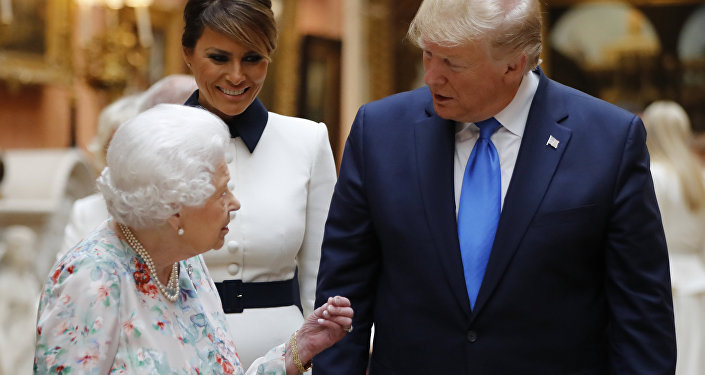 Britain's Queen Elizabeth speaks to U.S President Donald Trump and First Lady Melania Trump as they view U.S memorabilia from the Royal Collection, at Buckingham Palace, London, Monday, June 3, 2019