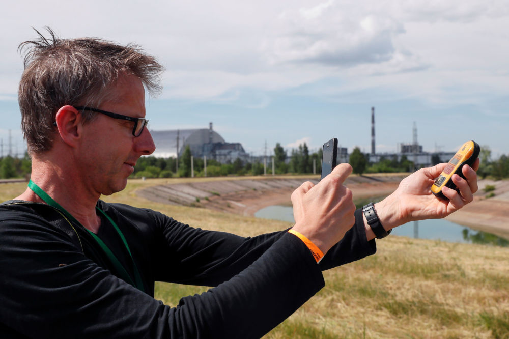 Visitor Takes a Picture of a Dosimeter Near the New Safe Confinement