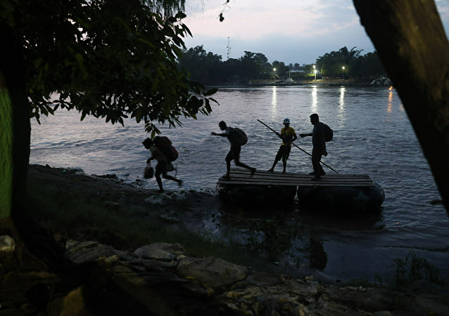 Migrants on rafts reach the Mexico shore after crossing the Suchiate river on the Guatemala – Mexico border, near Ciudad Hidalgo, Mexico, Wednesday, June 5, 2019