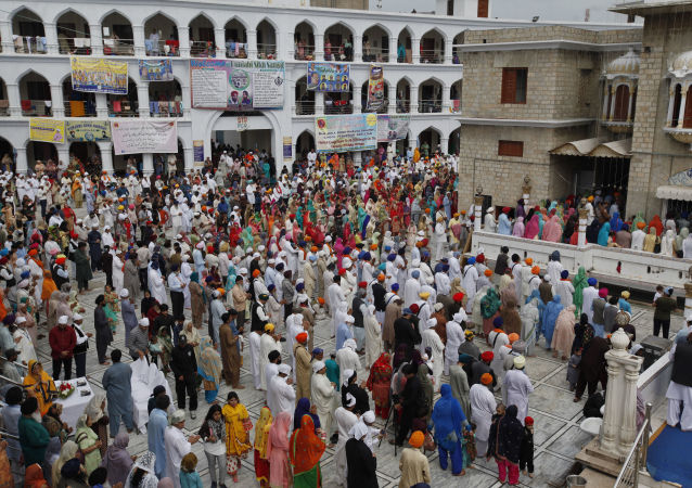 Sikh pilgrims pray during the Vasakhi festival, at the shrine of Gurdwara Punja Sahib, the second most sacred place for Sikhs, in Hasan Abdal, some 50 kilometers (31 Miles) from Islamabad, Pakistan, Sunday, April 14, 2019.
