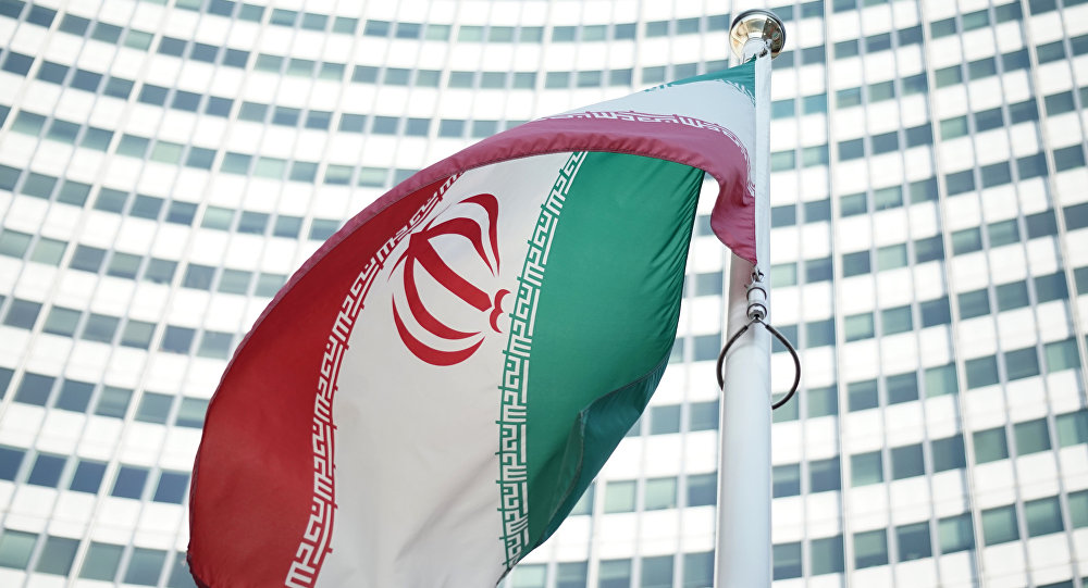 An Iranian flag waves in a wind outside the Vienna International Centre hosting the United Nations (UN) headquarters and the International Atomic Energy Agency (IAEA) as the socalled EU 5+1 talks with Iran take place in Vienna, on July 3, 2014