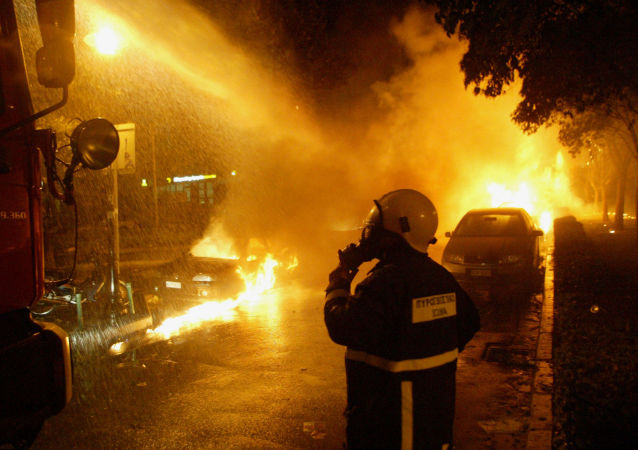 Firefighters try to extinguish a fire during a in the northern Greek port city of Thessaloniki (File)