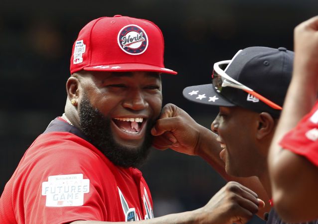 In this July 15, 2018, file photo, World Team Manager David Ortiz (34) speaks with U.S. Team Manager Torrii Hunter, before the All-Star Futures baseball game at Nationals Park, in Washington. Ortiz returned to Boston for medical care after being shot in a bar Sunday, June 9, 2019, in his native Dominican Republic.
