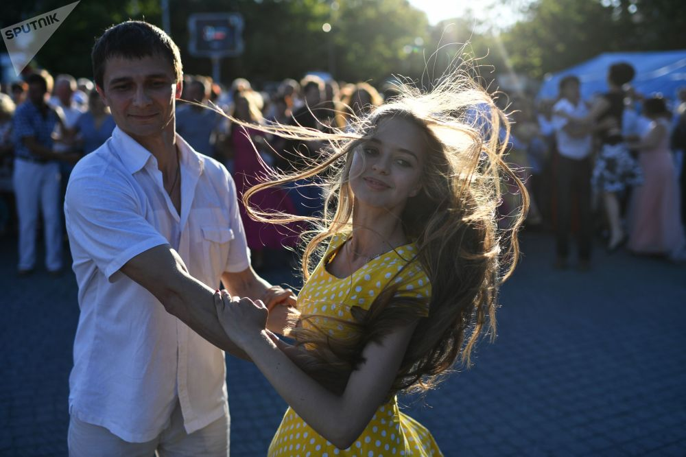 A couple dancing in a park in Sevastopol, Crimea, Russia.