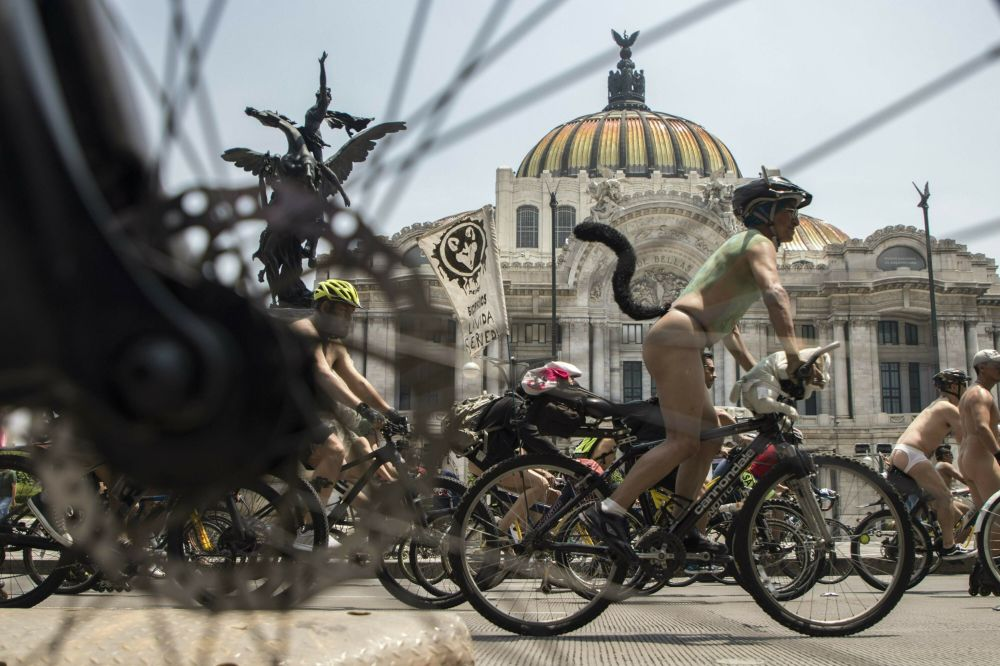 Naked cyclists ride through the streets of Mexico City during the World Naked Bike Ride day, Saturday, June 8, 2019.