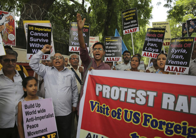 Activists of various left organizations denounce American policies while protesting against the upcoming visit of U.S. Secretary of State Mike Pompeo to India, in New Delhi, India, Tuesday, June 25, 2019. Pompeo is scheduled to travel to India after having visited Saudi Arabia and the United Arab Emirates, on a trip aimed at building a global coalition to counter Iran