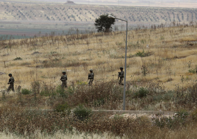 Turkish soldiers walk at the Atmeh crossing on the Syrian-Turkish border, as seen from the Syrian side, in Idlib governorate, Syria May 31, 2019