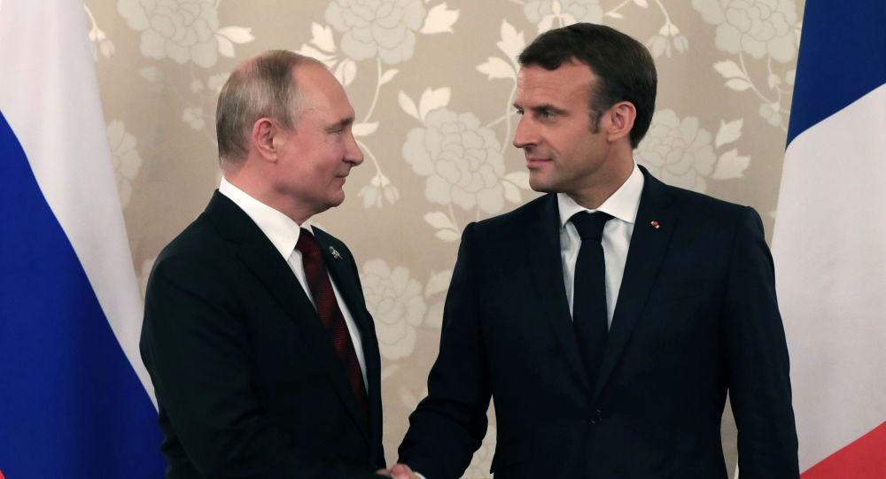 Russian President Vladimir Putin Shakes Hands with French President Emmanuel Macron
