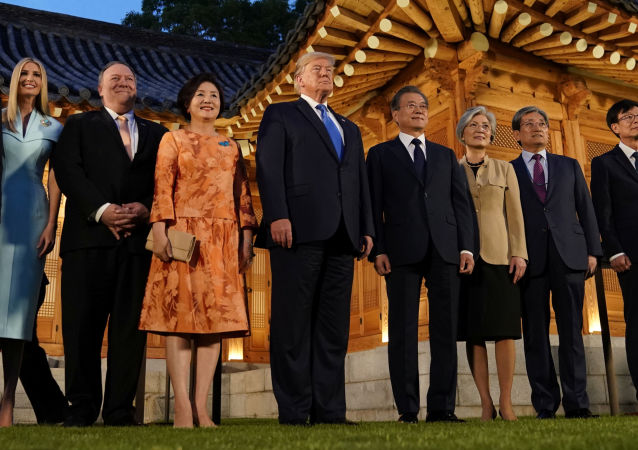 South Korea's President Moon Jae-in, U.S. President Donald Trump and their delegations pose for a picture before a dinner at the Presidential Blue House in Seoul, South Korea, June 29, 2019.