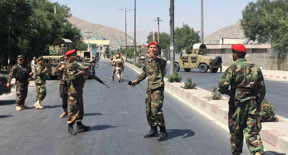 Afghan security forces arrive at the site of an explosion in Kabul, Afghanistan, Monday, July 1, 2019
