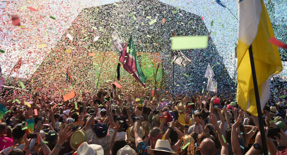 Revellers cheer as Australian singer Kylie performs at the Glastonbury Festival of Music and Performing Arts on Worthy Farm near the village of Pilton in Somerset, South West England, on June 30, 2019