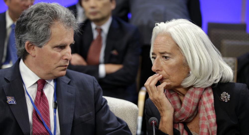 International Monetary Fund (IMF) Managing Director Christine Lagarde, right, speaks with First Deputy Managing Director of the International Monetary Fund, David Lipton