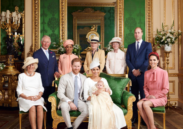 This official christening photograph released by the Duke and Duchess shows Prince Harry, Duke of Sussex and Meghan, Duchess of Sussex with their son, Archie and the Duchess of Cornwall, Britain's Prince Charles, Prince of Wales, Ms Doria Ragland, Lady Jane Fellowes, Lady Sarah McCorquodale, Prince William, Duke of Cambridge and Catherine, Duchess of Cambridge in the Green Drawing Room at Windsor Castle, near London, Britain July 6, 2019.