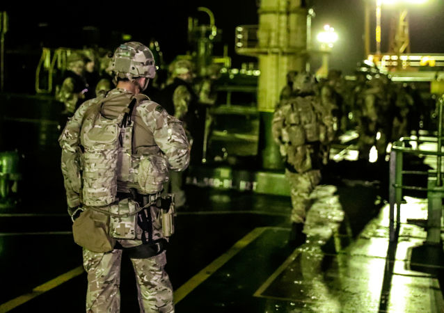 A British soldiers are seen during an operation involving the oil supertanker Grace 1, that's on suspicion of carrying Iranian crude oil to Syria, in waters off the British overseas territory of Gibraltar, historically claimed by Spain, July 4, 2019. Picture taken July 4, 2019