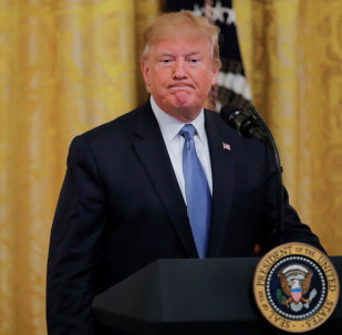 U.S. President Donald Trump arrives to speak about his administration's environmental policy in the East Room of the White House in Washington, U.S., July 8, 2019