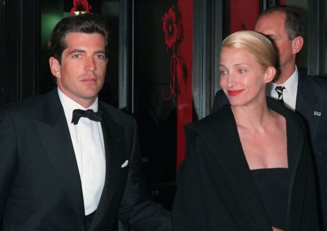 In a file photo John F. Kennedy, Jr. and his wife, Carolyn Bessette Kennedy, arrive at the Minskoff Theatre Monday night, April 6, 1998