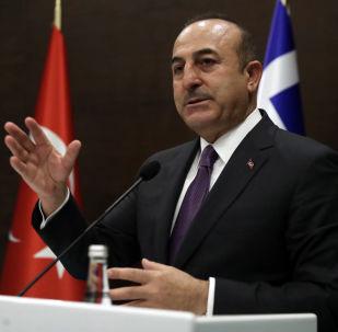 Turkey's Foreign Minister Mevlut Cavusoglu speaks to the media