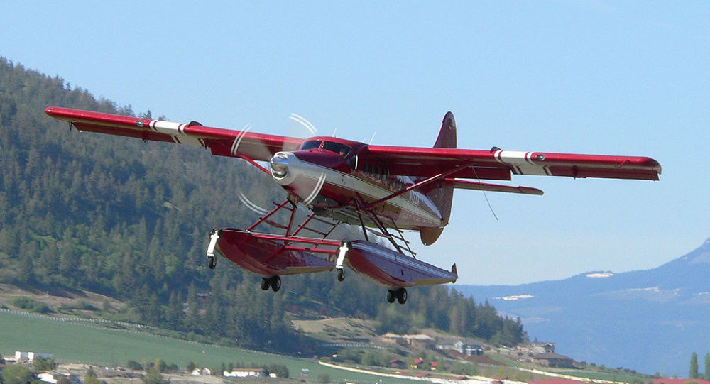 This April 29, 2005 photo released by John Olafson, shows an aircraft with tail number N455A, leaving Vernon, British Columbia, Canada and headed to Alaska.