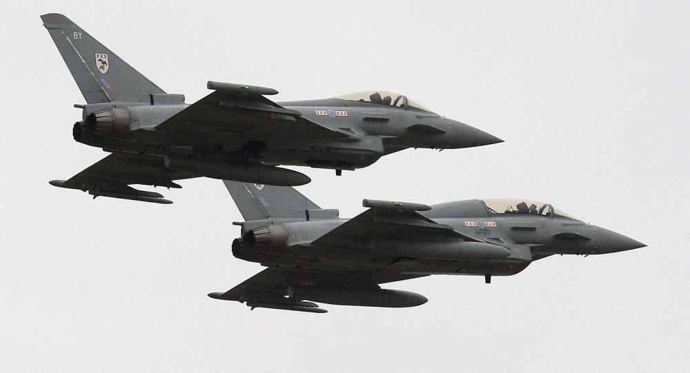 Two British Royal Air Force Typhoon FGR4 aircraft fly over RAF Waddington near Lincoln, England (File)