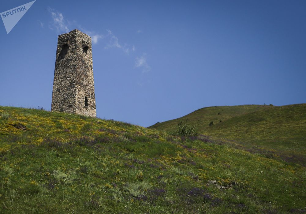 An ancient tower is pictured near the City of the Dead, a medieval Alanian burial site and a local branch of the North Ossetian National Museum near the village of Dargavs, Russia's Republic of North Ossetia - Alania.