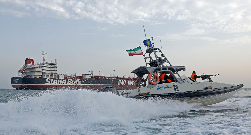 A picture taken on July 21, 2019, shows Iranian Revolutionary Guards patrolling around the British-flagged tanker Stena Impero as it's anchored off the Iranian port city of Bandar Abbas