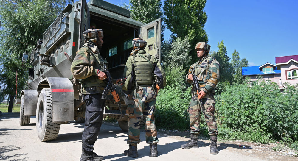 Indian army soldiers stands near the site of a gun battle between a suspected militant and Indian government forces in Kanipora area of Nowgam in central Kashmir's Budgam district on June 28, 2019