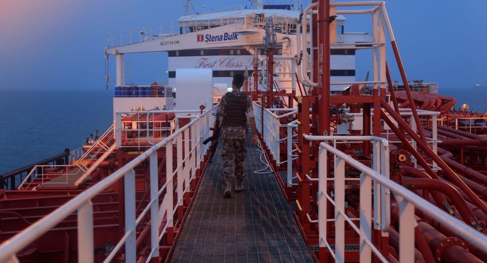 An Iranian Revolutionary Guard member walks onboard of Stena Impero, a British-flagged vessel owned by Stena Bulk, in Bandar Abbas port, Iran July 21, 2019. Picture taken July 21, 2019