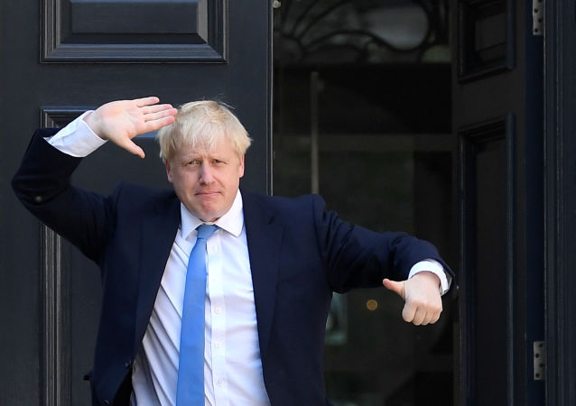 Boris Johnson gestures as he arrives at the Conservative Party headquarters, after being announced as Britain's next Prime Minister, in London, Britain July 23, 2019