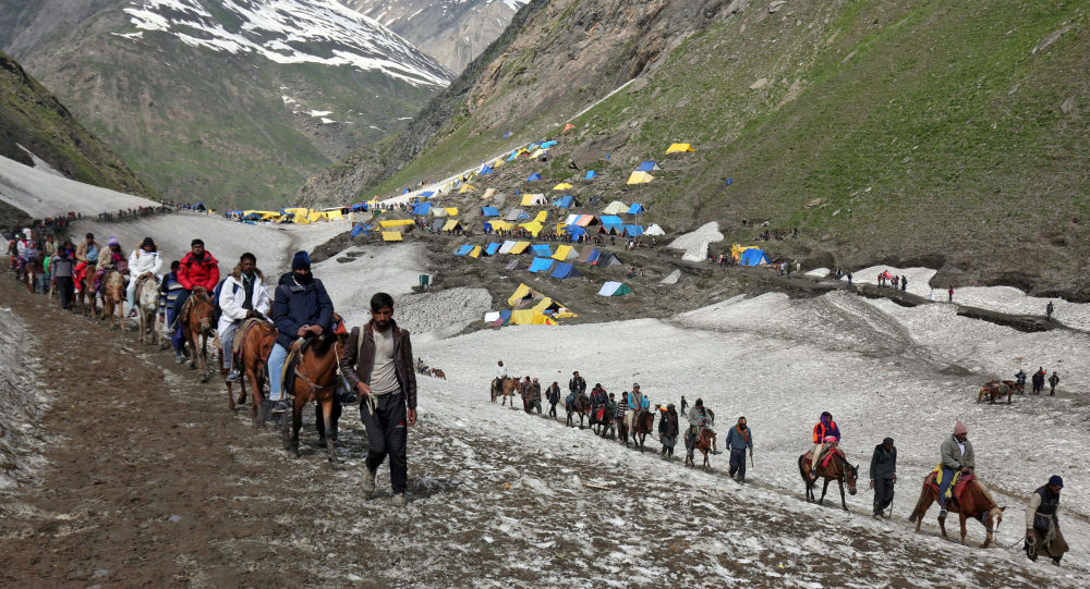 Hindu pilgrims treck through mountains to reach the Amarnath cave shrine where they worship an ice stalagmite that Hindus believe to be the symbol of Lord Shiva, at Sangam Top in the Kashmir region, July 6, 2019