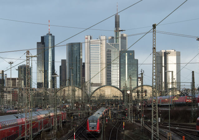 A picture taken on January 3, 2018 shows railways at the train station and a view of the skyline in Frankfurt am Main, western Germany