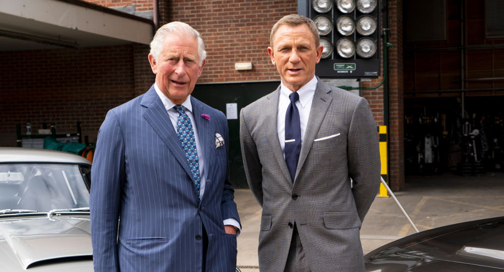 Britain's Prince Charles, Prince of Wales poses with British actor Daniel Craig as he tours the set of the 25th James Bond Film at Pinewood Studios in Iver Heath, west of London, on June 20, 2019. T